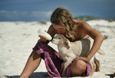 Helping eachother: Robyn taking time out to feed a baby goat, Robyn's diet also consisted of drinking a lot goats milk of on her 1700 mile journey